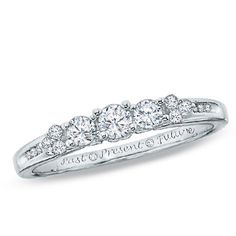 I know it's just billed as a promise ring, but I love it. 0.33 CT. T.W. Diamond Three Stone Ring in 14K White Gold - Peoples Jewellers