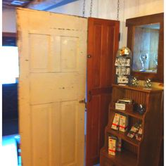 Old doors suspended from ceiling as a room divider or privacy space. Armstrong Valley Winery in Halifax, Pennsylvania.