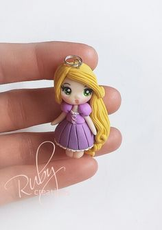 Polymer clay Rapunzel doll necklace pendant by Ruby creations. Follow me on facebook: https://m.facebook.com/profile.php?id=1441357136106288&_rdr