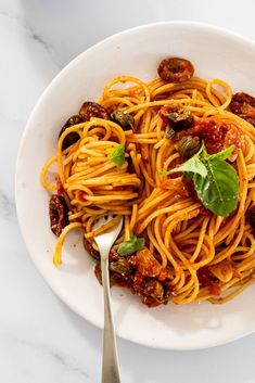 Pasta Puttanesca is the perfect pantry meal. Full of punchy flavors like olives, capers and garlic, it's a guaranteed showstopper. #dinner #pasta Yummy Pasta Recipes, Easy Dinner Recipes, Summer Recipes, Cooking Recipes, Delicious Recipes, Dinner Ideas, Pasta Puttanesca, Pasta Shapes, Fresh Garlic