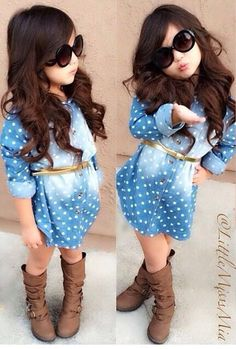 Adorable.  Dress, belt, shoes, and her hair and sunglasses make this styling amazing!  Love everything.