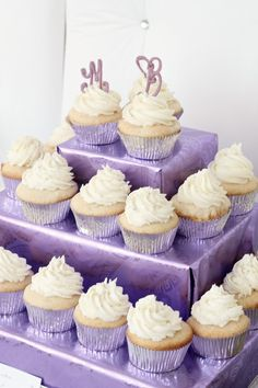 Low-cost cupcake stand---boxes of different sizes covered in pretty wrapping paper