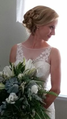Bridal Nose Gay with Succulents, White Oriental Lilies, and many selections of greenery for texture.