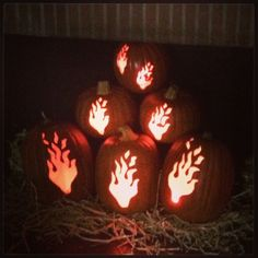 Pin for Later: Take Pumpkin Carving to the Next Level With These Stylish Ideas Fireplace Pumpkins Pile flame pumpkins in your fireplace instead of lighting an actual fire.