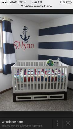 Love the minimalist look of this nursery. And the baby's name on the wall. :)