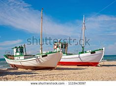A photo of a Danish fishing boat at the beach by Dhoxax, via Shutterstock