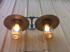 This light fixture was purchased at a Habitat Store with no globes. An easy fix was to glue mason jar lids to the fixture and screw on a mason jar. Lighting Globes And Shades, Light Shades, Rustic Light Fixtures, Rustic Lighting, Lighting Ideas, Industrial Lighting, Jar Lights, Globe Lights, Bottle Lights