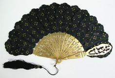 1855-68 Black Silk fan with satin leaves, gold pallettes, and gilt stocks. Museum of the City of New York.