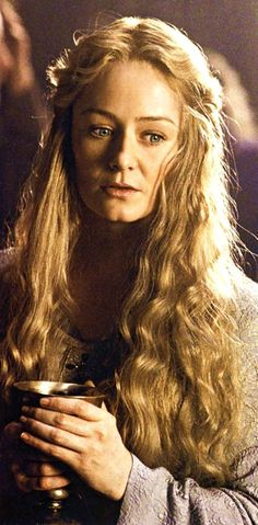 Eowyn...I always thought she was odd, but she's a girl character so I had to love her....also our hair kind of matches
