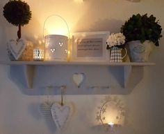 grey heart shelf. very shabby chic. love the candles.