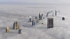 Now this is cool picture. The tallest skyscrapers break through the clouds in Dubai, UAE.