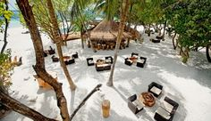 Constance Moofushi Resort: Sip unlimited cocktails at the tree-covered feet-in-the-sand Totem Bar.