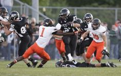 Perry sophomore Braxton Berry pushes through the Massillon defenders in week four of the high school football season.