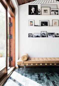 Gallery wall on picture ledges and a gorgeous woven leather bench