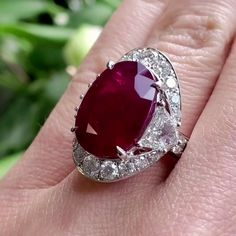Passion, Romance & Elegance all reflected in one Dazzling Cocktail Ring! This stunning Ruby Ring is crafted in solid18K White Gold, weighs approx. 13.2 grams and measures 21 mm x 23 mm x 9 mm (high). Yellow Diamond Engagement Ring, Antique Engagement Rings, Natural Diamonds, Round Diamonds, Deep Red Color, 9 Mm, Cocktail Rings, 18k Gold, Romance