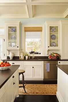 cream-colored cabinets. dark floors. coffered ceiling.