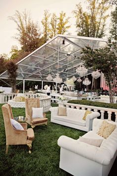 Bring the indoors out with tufted chairs, sofas and chandeliers.