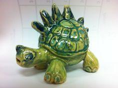 """Burt the Turtlesaurous"", ceramic whistle by Carmen Egolf"
