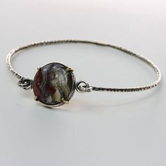 Round Mexican Banded crazy lace agate bangle bracelet in silver bezel and brass prongs setting with tension closure