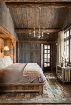 A lodge. It needs just a little more luxe for me... like a faux fur throw and crystal chandelier and sconce.