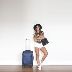 Blogger, Jinna, of Grease and Glamour in TUXE striped bodysuit. Gives tips on packing, travel tips, what the pack, travel fashion, travel style.