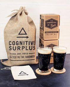"""For the true beer + chemistry lover, this pack comes with two beer chemistry pint glasses, individually packed in printed boxes and two eco-friendly """"It's EtOH O'clock Somewhere"""" cork coasters in their own custom cloth bag. The coasters and all the bags are screen printed by hand in Portland, OR. The whole kit ships in a large gift bag tied up with string. Each glass contains:humuleneglucosemyrcenecis-isohumuloneethanolfructosemaltosewater(Well, the formulae, anyway…) Just add beer! Social…"""