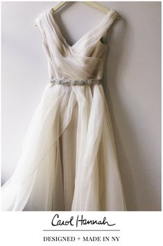 Carol Hannah Alurina gown from the Monarch Collection | Draped gauzy, light weight wedding dress with asymmetrical neckline and floating ballgown skirt. Deep v back and v front neckline. Vintage inspired, designer runway bridal dress. Shown with Crystal Vines belt by Carol Hannah.