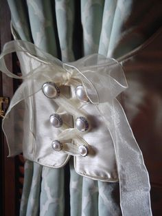 Use as a curtain tiebacks.