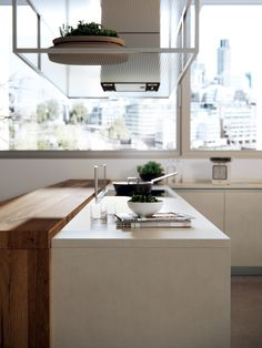 Gres adds value and, when combined with wooden stains, interprets timeless, versatile elegance. LiberaMente kitchens by Scavolini