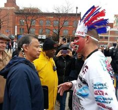 The awkward moment when Robert Roche of the American Indian Movement (left) is confronted by Pedro Rodriguez (right), who is donning redface...