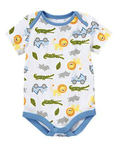 for some reason, I'm just in love with this onesie--and the matching striped pants! such cheerful little lions . . .