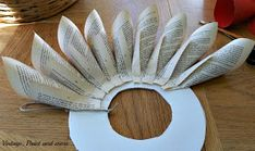 book page wreath tutorial, crafts, wreaths, Simply fold pages and glue onto a wreath form Mine is made from a piece of foam core Old Book Crafts, Book Page Crafts, Book Page Art, Book Pages, Folded Book Art, Book Folding, Paper Folding, Wreath Crafts, Diy Wreath