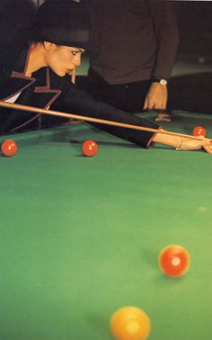 Bianca Jagger shooting pool, by Eric Boman 1974. Her suits are always so cool.