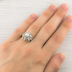 Reminds me of a carnival tent or merry-go-round. Edwardian Dome Engagement Ring