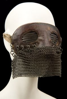 Masks like this one were worn by British crews in tanks during the First World War. The leather mask is shaped to fit around the eyes and nose and the chain mail was used to protect against splinters from explosions as the tank came under fire.