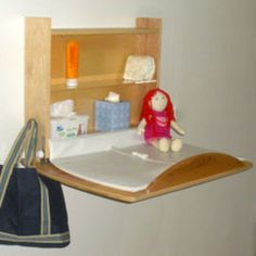 Wall Mounted Changing Table. I wonder if John could build us one of these when we have another baby. Big time space saver!