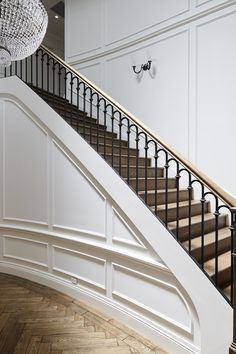 Staircase | American Oak | Continuous Rail | Curved Stair | Traditional | Posts | Herringbone Pattern | Wrought Iron Balustrade | Handrail | Architecture | Design