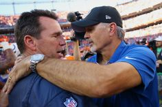 DENVER, CO - SEPTEMBER 18:  Head coach Gary Kubiak of the Denver Broncos shakes hands with head coach Chuck Pagano of the Indianapolis Colts after the broncos won 34-20 at Sports Authority Field at Mile High on September 18, 2016 in Denver, Colorado. (Photo by Justin Edmonds/Getty Images)