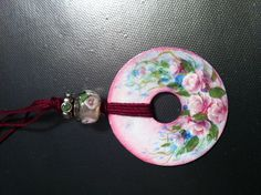 A necklace made from a washer with tiny roses painted on it.  How fun is this! Design by Lonna's Stroke of Art