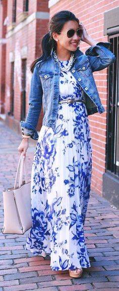 Long white & blue floral maxi dress with jean jacket. Accessorized with neutral color bag and aviator sunglasses.