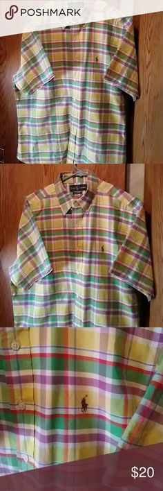 Ralph Lauren shirt Short sleeve button up shirt. Classic fit size L. Yellow, Green  Purple plaid. Gently preownef. Excellent condition.  Smoker and pets in the home. Questions and offers welcome. Ralph Lauren Shirts Casual Button Down Shirts
