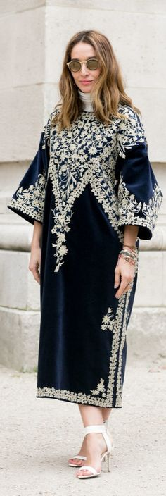 Paris Fashion Week street style: a velvet embroidered caftan, strappy sandals and round sunglasses