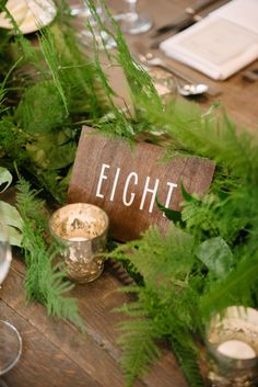Rustic wooden table number: http://www.stylemepretty.com/new-york-weddings/hudson-valley/2017/01/19/mixing-romance-and-greenery-with-a-stunning-rustic-backdrop/ Photography: Brian Hatton - http://brianhattonweddings.com/