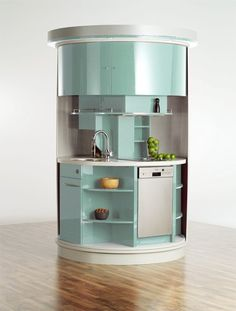 """Taking up just 20 square feet, this circle kitchen promises to """"rotate up to 180 degrees to give you a sink, microwave, and dishwasher"""" along with """"the same amount of kitchen cupboard as any other middle-sized kitchen."""" Sounds kind of crazy, right? I thought so, too!"""