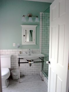 Pretty white subway tile with grey grout & seafoam paint.