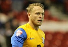 Tom Clarke has insisted that automatic promotion is still within Preston North End's reach despite the gap which has opened up in front of them