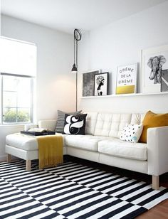 scandinavian living room white sofa with black & white throw pillows white & black stripes area rug single shelf in white wall ornaments of Be Simple yet Modern with These Black and White Living Room Sets Home Living Room, Living Room Designs, Living Room Decor, Apartment Living, Danish Living Room, Living Spaces, Apartment Furniture, Decor Room, Room Art