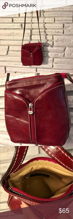 Italian Red Leather Purse. Adorable 💕 Genuine Italian Leather Purse. Unique zipper design. Deep red leather outer with tan leather lining. Perfect for adding a pop of red to any outfit. Bags Mini Bags