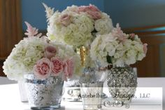 blush wedding flowers in a collection of silver mercury vases for a reception centerpiece by AntebellumDesign.com