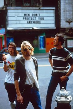 Nirvana + Jenny Holzer background - I've never seen this photo shoot in color, before!